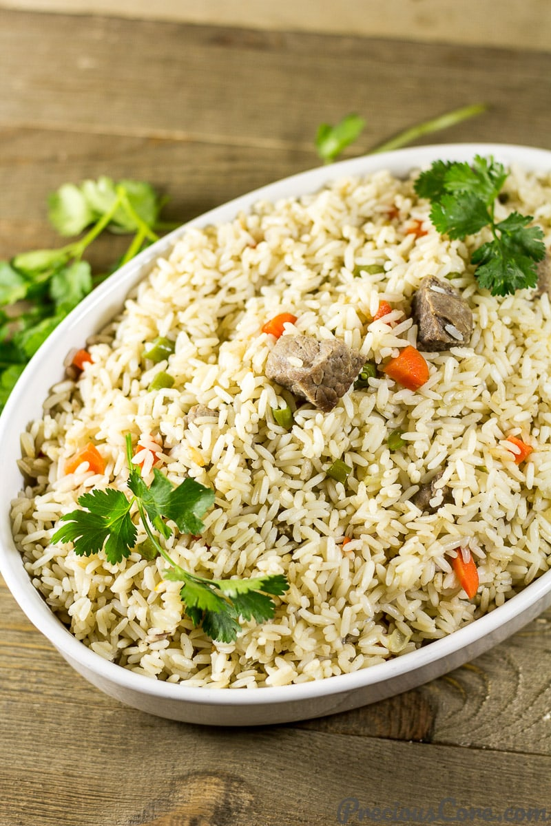 Cameroonian Coconut Rice - African coconut rice recipe. All you need is 10 ingredients and one-pot to make this coconut rice dinner. So good! Get the recipe on Precious Core. #onepot #dinner #easymeals #africanfood #preciouscore