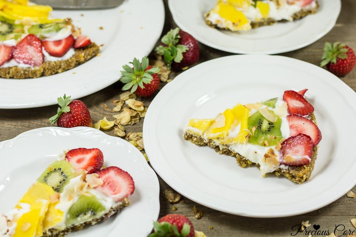 This breakfast pizza is made with a nutty cereal crust then topped with Greek yogurt and tropical fruits. A great quick and easy healthy breakfast recipe.