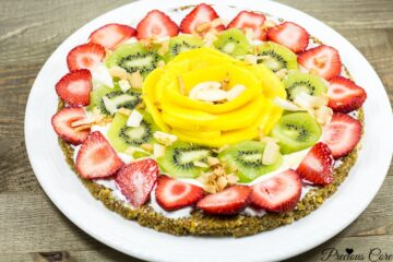 This breakfast pizza is made with a nutty cereal crust then topped with Greek yogurt and tropical fruits. It is a healthy, delicious, quick and easy breakfast recipe.