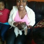 PRECIOUS HOLDS A DOG : OVERCOMING THE FEAR OF DOGS