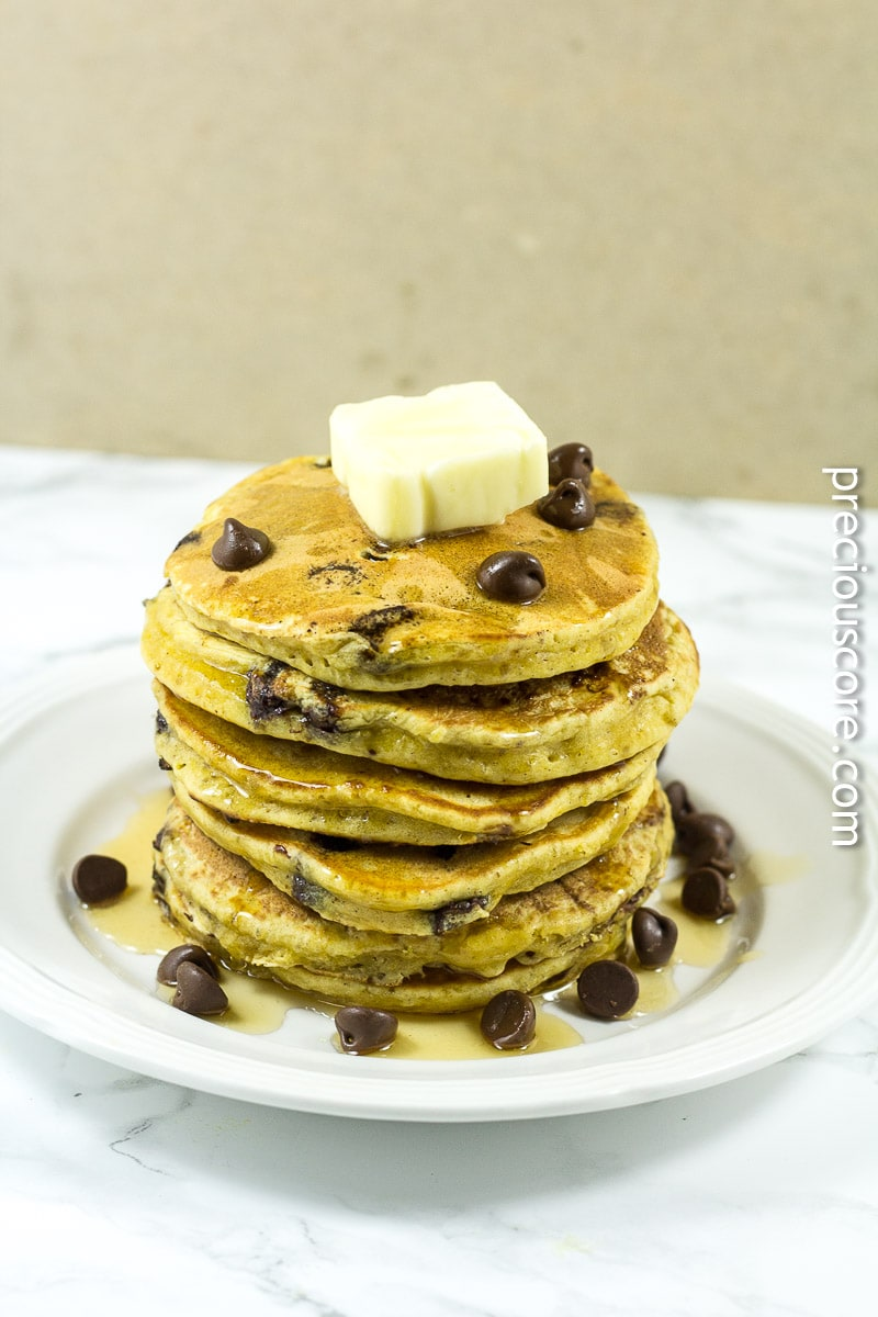 Pumpkin chocolate chip pancakes with butter, maple syrup and chocolate chips.