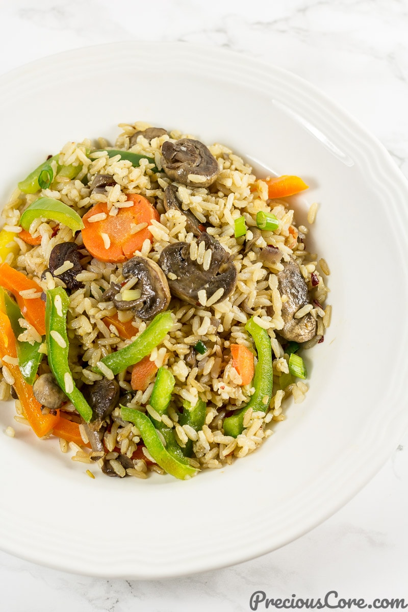 A plate of mushroom fried rice. Get mushroom fried rice recipe on Precious Core. #EasyDinner