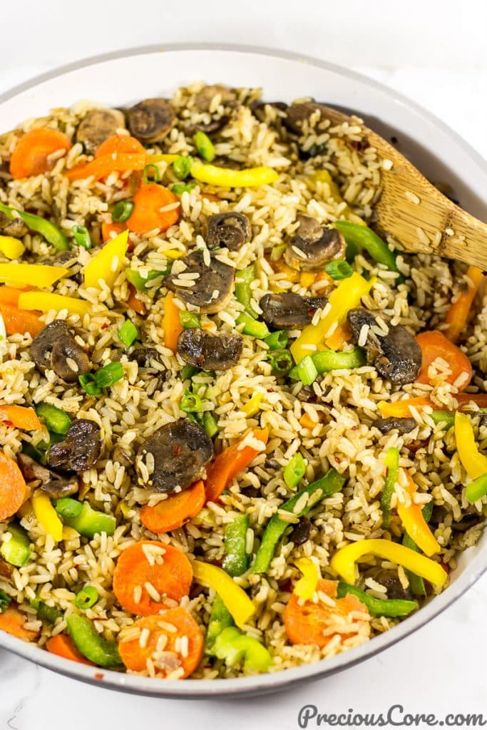 A pan of mushroom fried rice. Get mushroom fried rice recipe on Precious Core. #EasyDinner