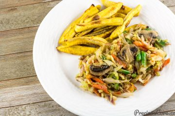 Cameroonian Cabbage Stew served with baked plantain fries.