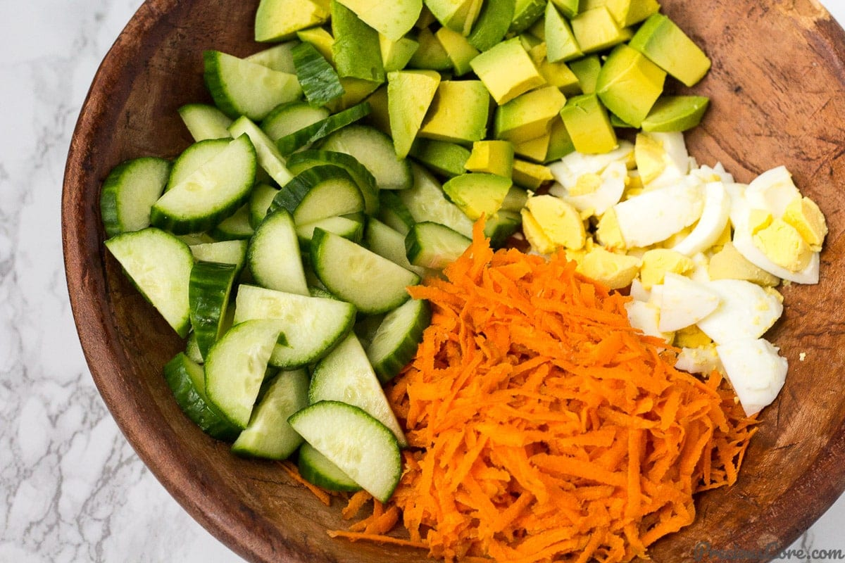 Breakfast Salad loaded with avocado, eggs and crunchy veggies.