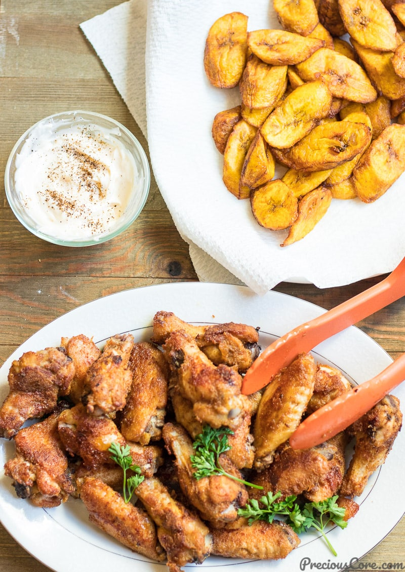 oven grilled chicken wings served with sweet fried plantains and herby mayo