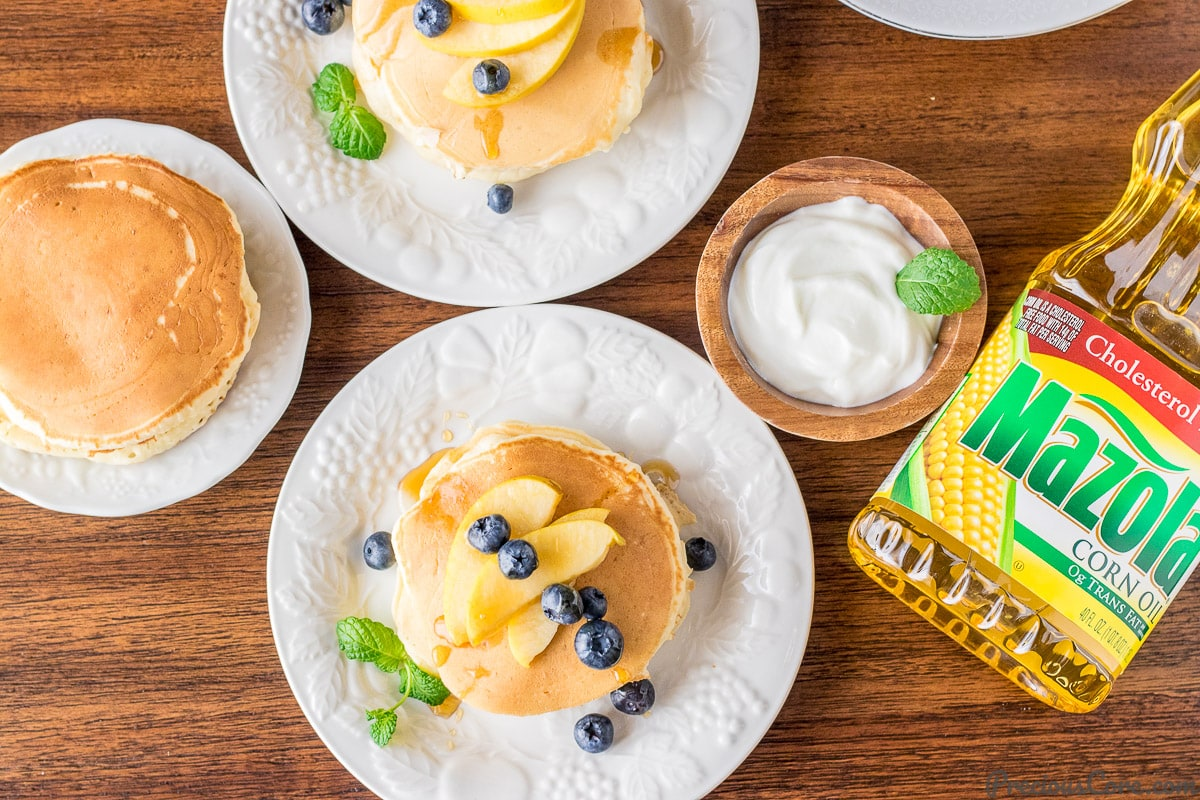 Healthier old fashioned pancakes served with Greek yogurt and fruit