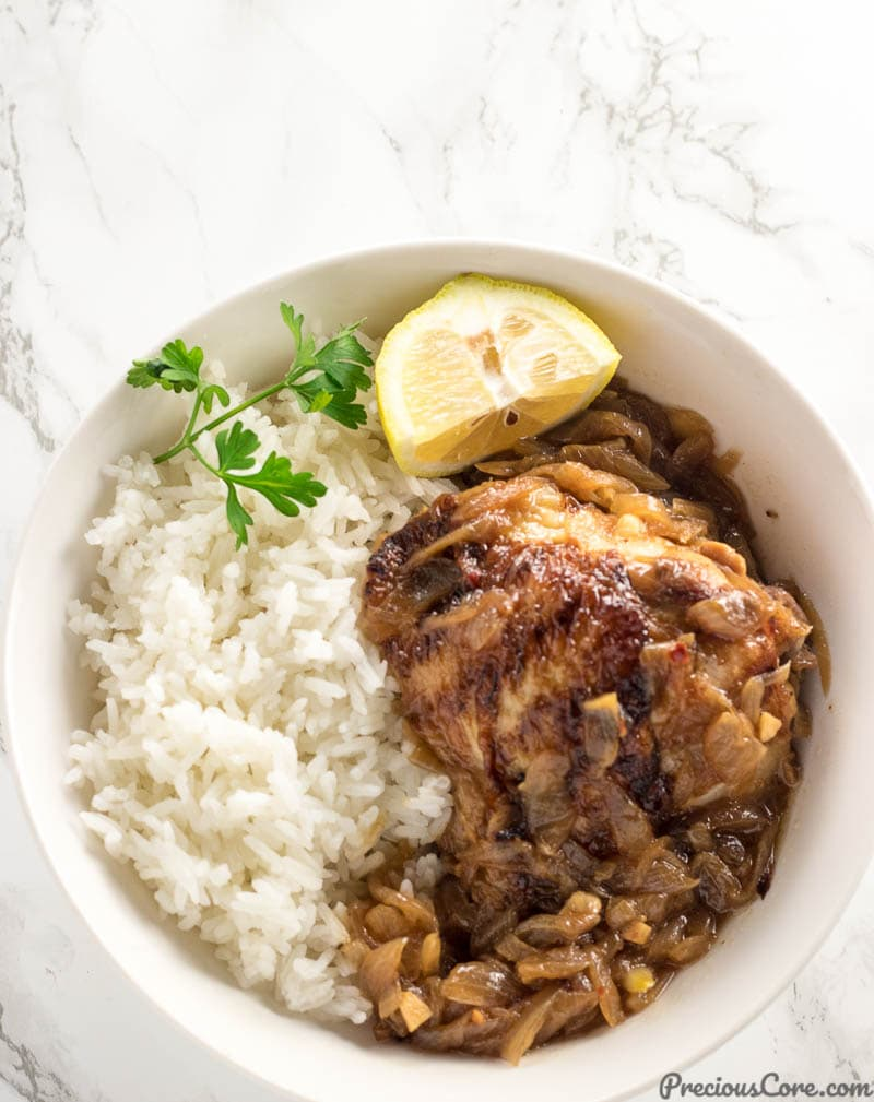 Poulet Yassa or Chicken Yassa served with rice.