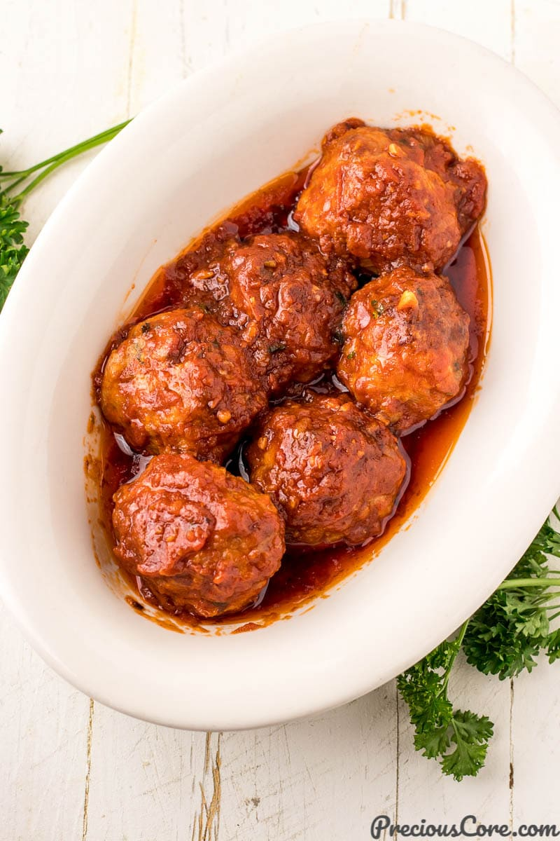 Chicken meatballs with tomato sauce in serving bowl