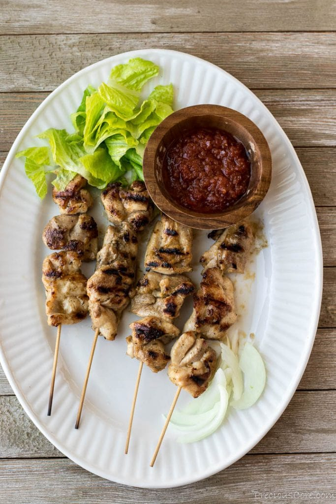 Chicken skewers on serving platter