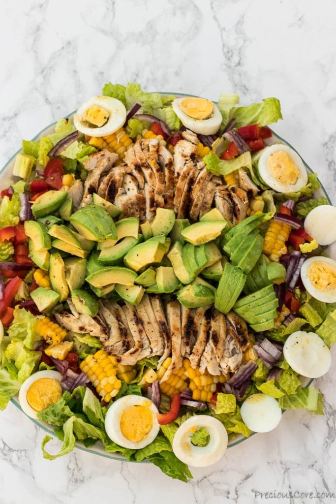 Healthy chicken avocado salad on platter