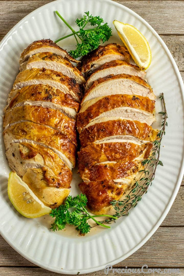 2 sliced baked turkey breasts on serving platter