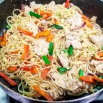Stir fry with spaghetti and chicken in a pan