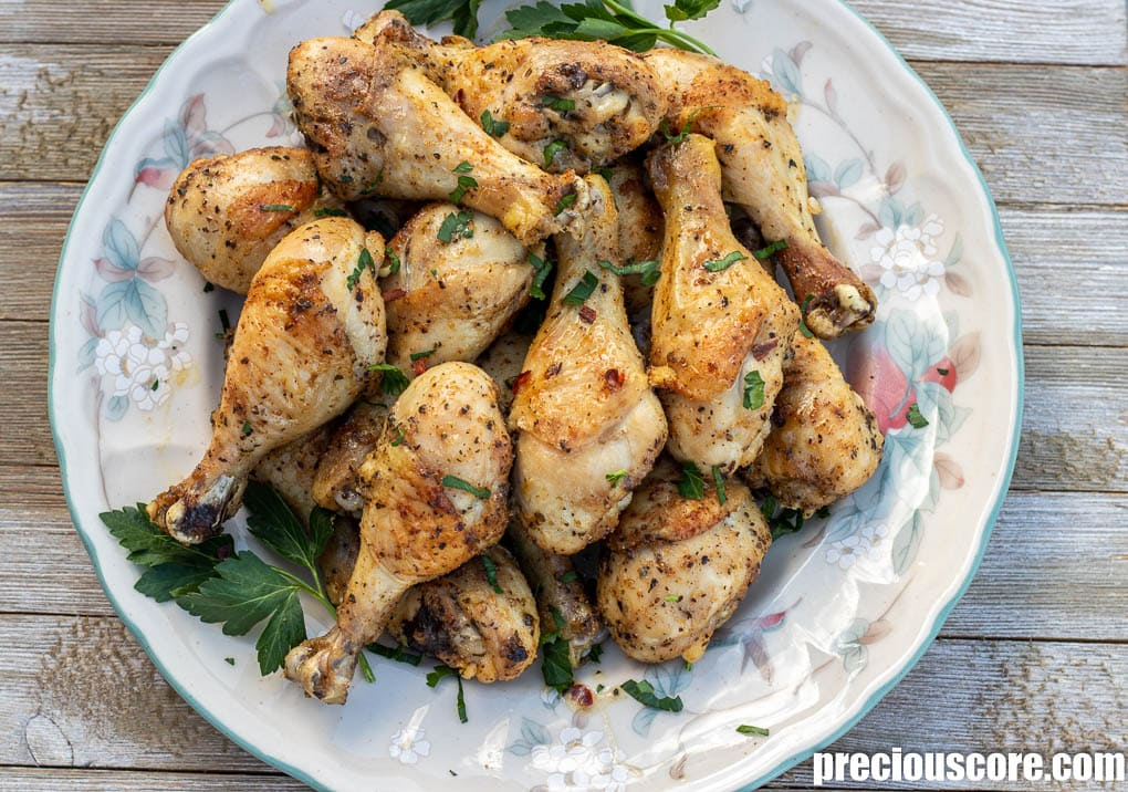 oven baked chicken drumsticks or legs on a serving platter