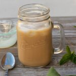 creamy iced coffee in a mason jar
