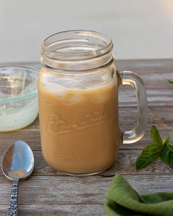 creamy iced coffee in a mason jar