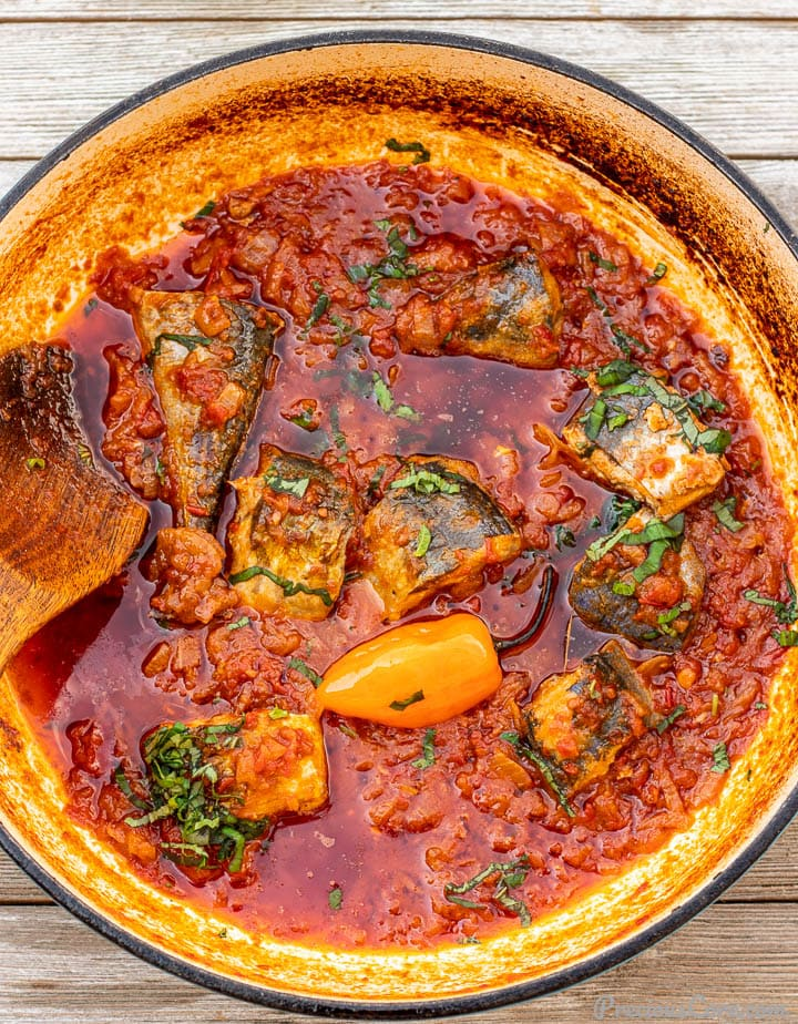 Tomato based fish stew in a saute pot
