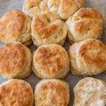 baked biscuits on parchment paper on a baking sheet