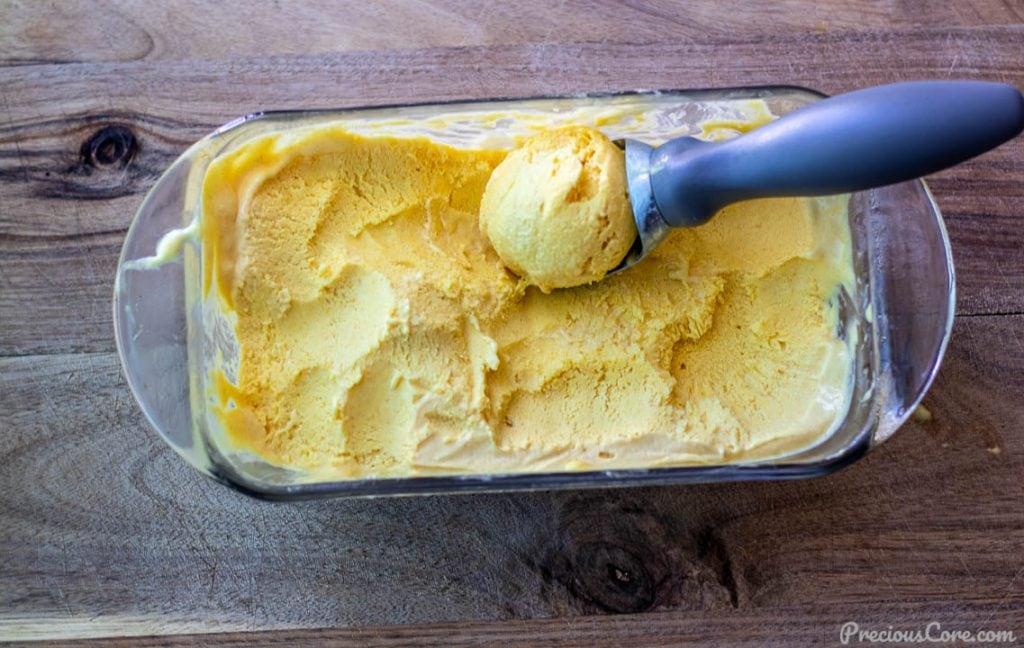 homemade mango no-churn ice cream in a loaf pan