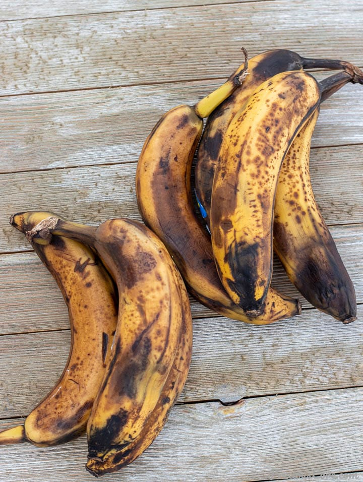 Overripe bananas on wooden board