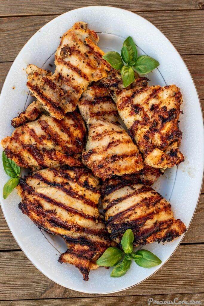 grilled boneless chicken thighs on a platter