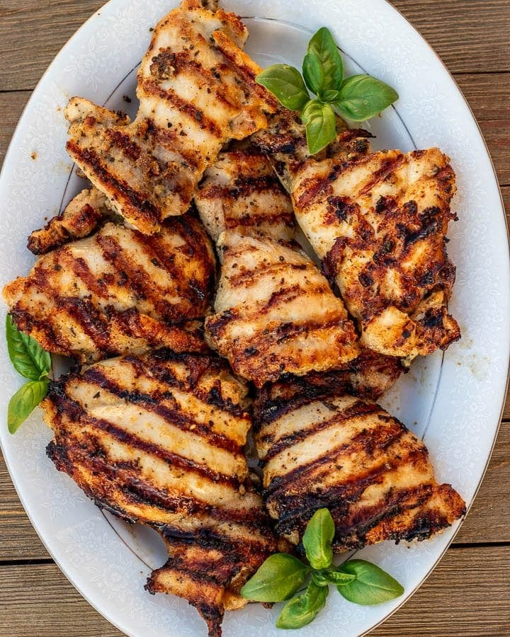 grilled boneless chicken thighs on a platter