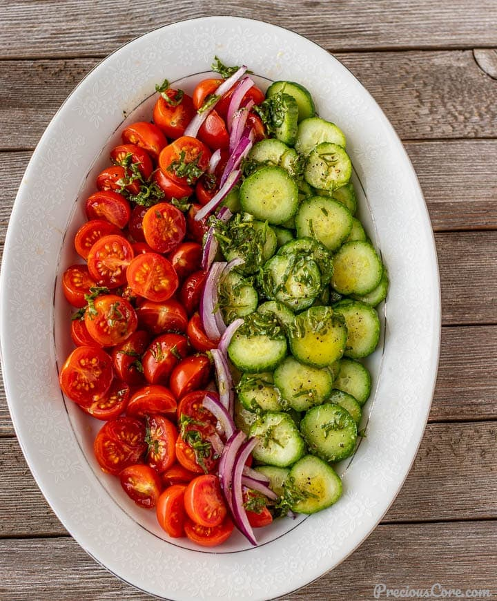 tomato cucumber salad on a platter