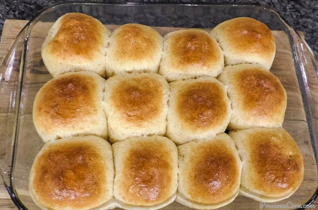 freshly baked golden brown dinner rolls in a baking dish
