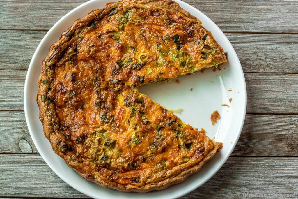 Quiche with a slice cut out