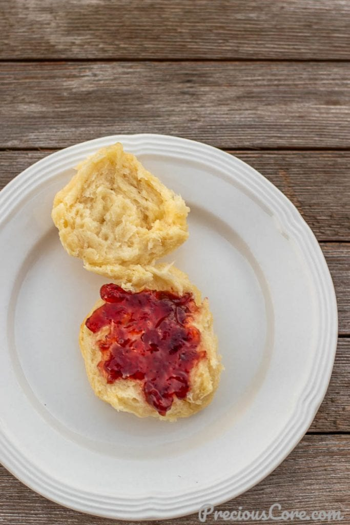 1 BISCUIT ON A PLATE WITH JAM SPREAD ON TOP