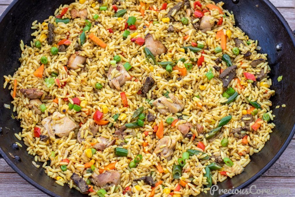 Wok of fried rice with chicken and liver